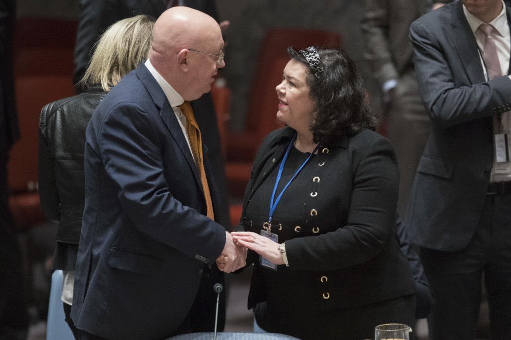 Russian Ambassador to the United Nations Vassily Nebenzia, left, greets British Ambassador to the United Nations Karen Pierce before a Security Counci