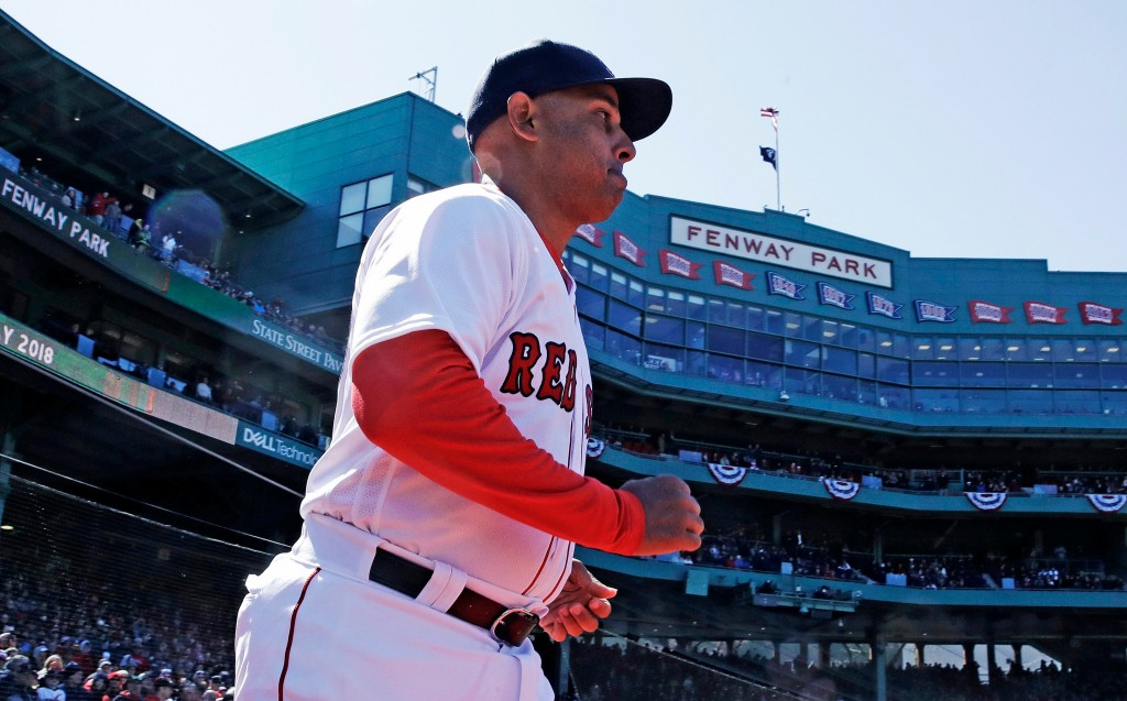 Boston Red Sox manager Alex Cora runs onto the field as he is introduced during ceremonies prior to a home opener baseball game against the Tampa Bay ...