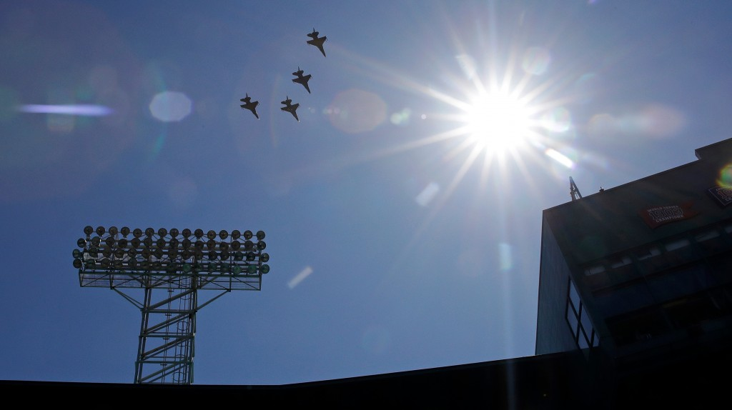 Four F-16's, from the Air National Guard's 134th Fighter Squadron in Burlington, Vermont fly over during ceremonies prior to a home opener baseball ga...