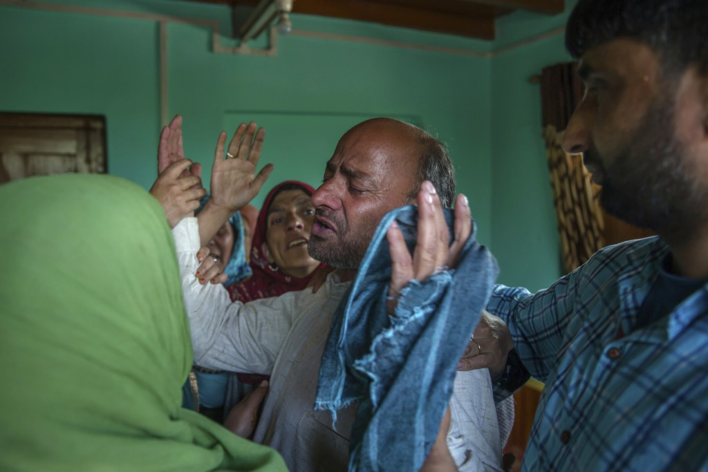 In this April 6, 2018, photo, Abdul Gaffar mourns the killing of his son Manzoor Ahmed Bhat, who was abducted, and later killed by suspected militants...