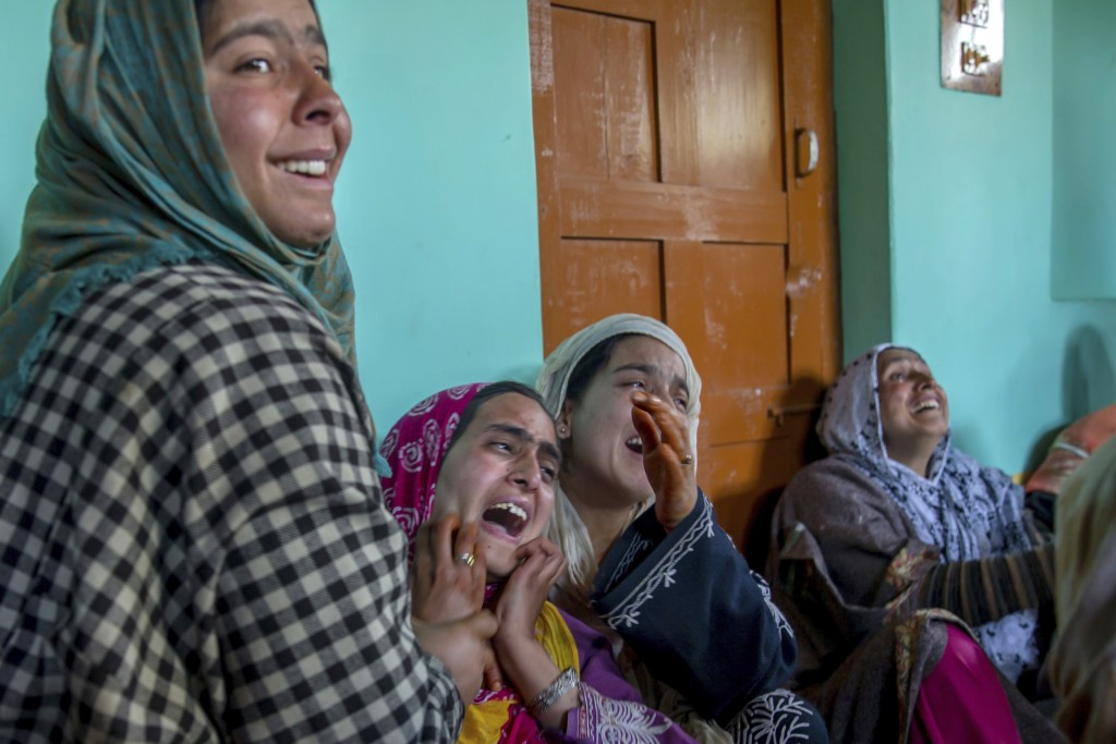 In this April 6, 2018, photo, Kashmiri women mourn the killing of their relative Manzoor Ahmed Bhat, who was abducted and later killed by suspected mi...
