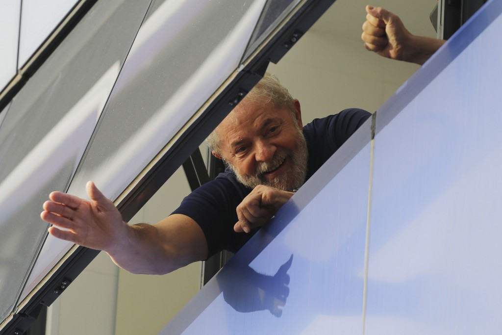 FILE - In this April 7, 2018 file photo, Brazil's former President Luiz Inacio Lula da Silva waves to supporters from a window of the Metal Workers Un