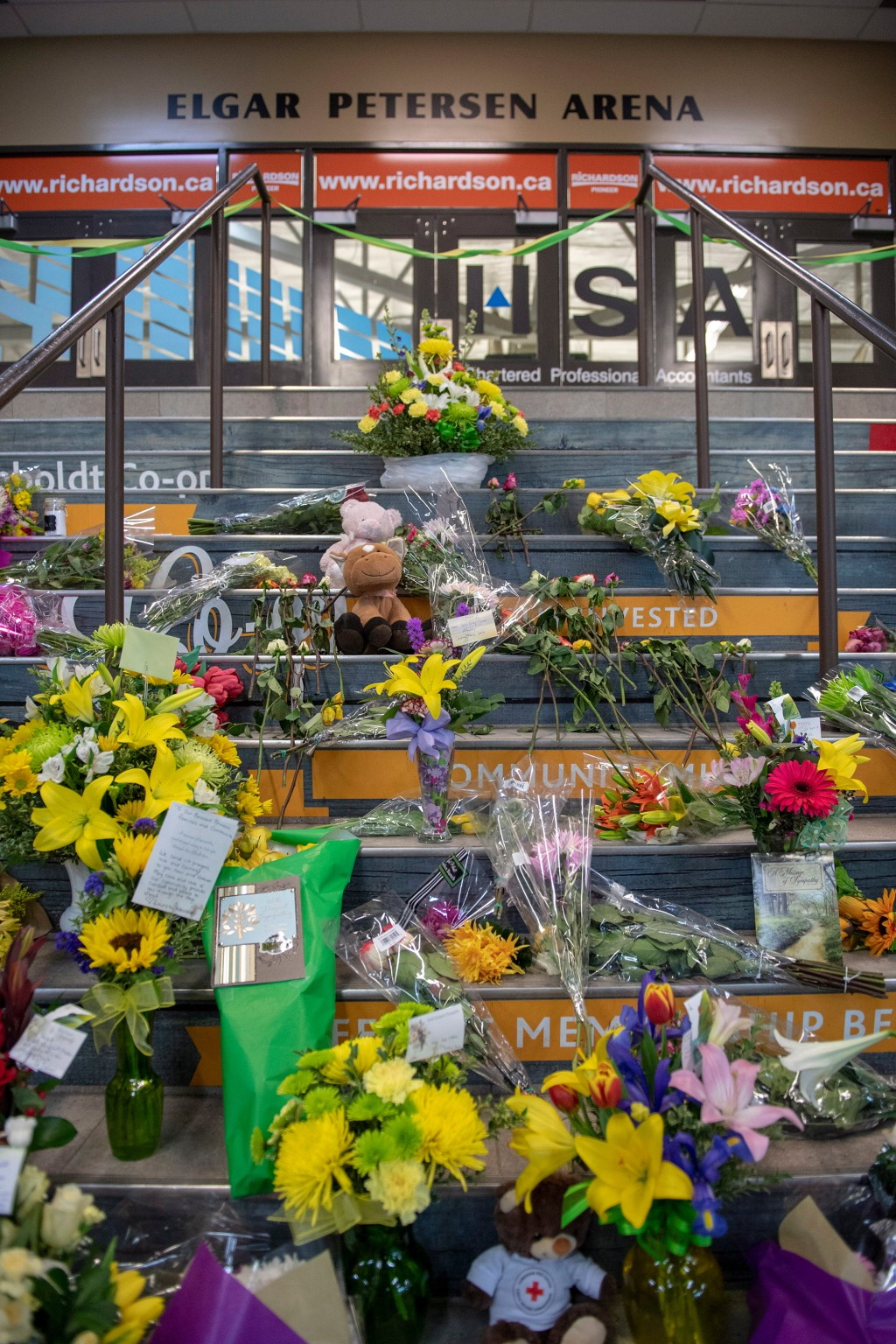 A memorial sits at the stairs that lead to Elgar Petersen Arena in Humboldt, Saskatchewan on Sunday, April 8, 2018. Multiple  people traveling with th...