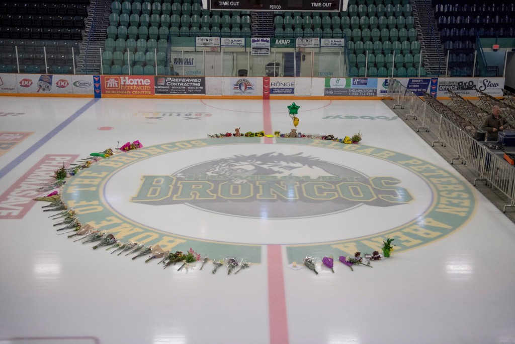 Flowers are shown at center ice as preparations are made at Elgar Petersen Arena for a vigil tonight in Humboldt, Saskatchewan, Sunday, April 8, 2018....