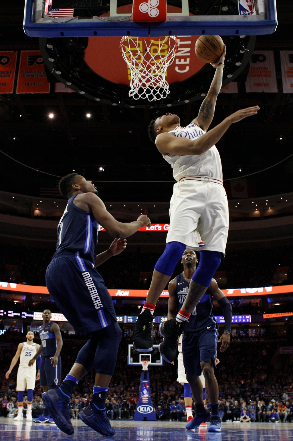 Philadelphia 76ers' Markelle Fultz, right, shoots with Dallas Mavericks' Dennis Smith Jr., left, defending during the first half of an NBA basketball ...