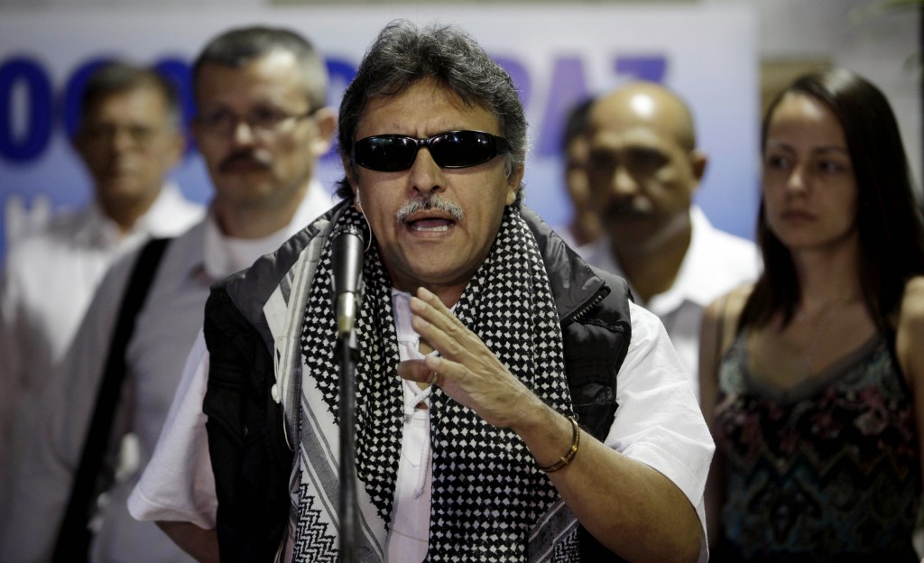 FILE - In this March 11, 2013 file photo, Jesus Santrich, member of the negotiating team for Colombia's Revolutionary Armed Forces of Colombia (FARC),...