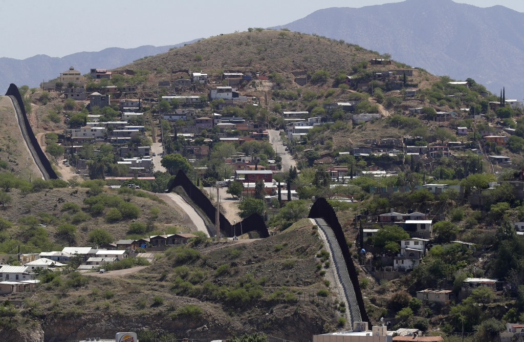 The International border cuts through Nogales Sonora Mexico right and Nogales Ariz. as seen Tuesday