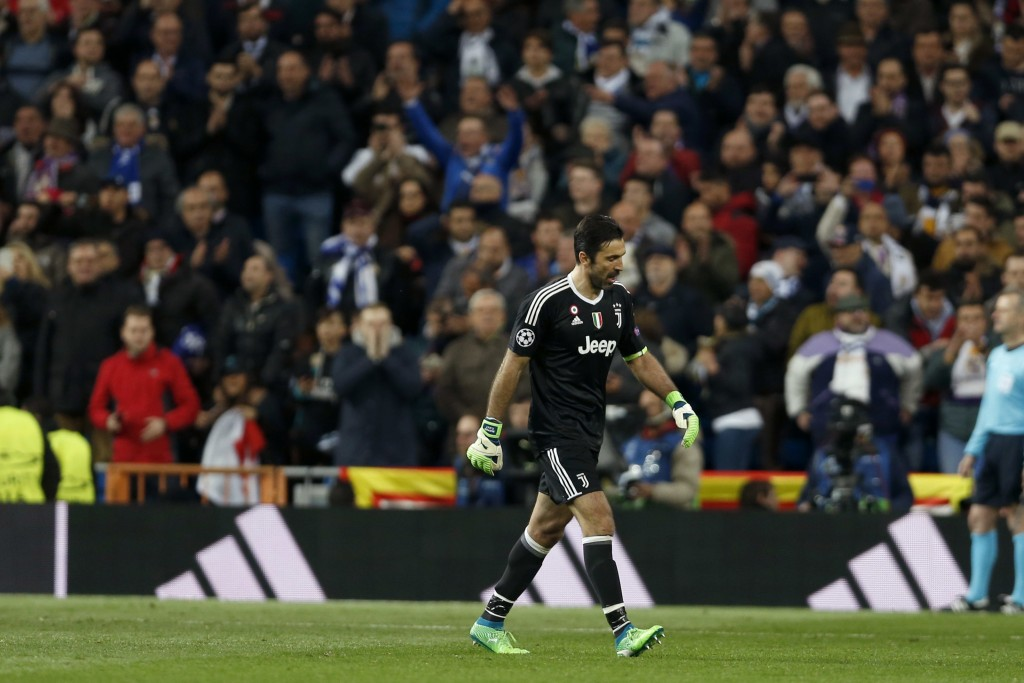 Juventus goalkeeper Gianluigi Buffon leaves the game after receiving a red card during a Champions League quarter final second leg soccer match betwe