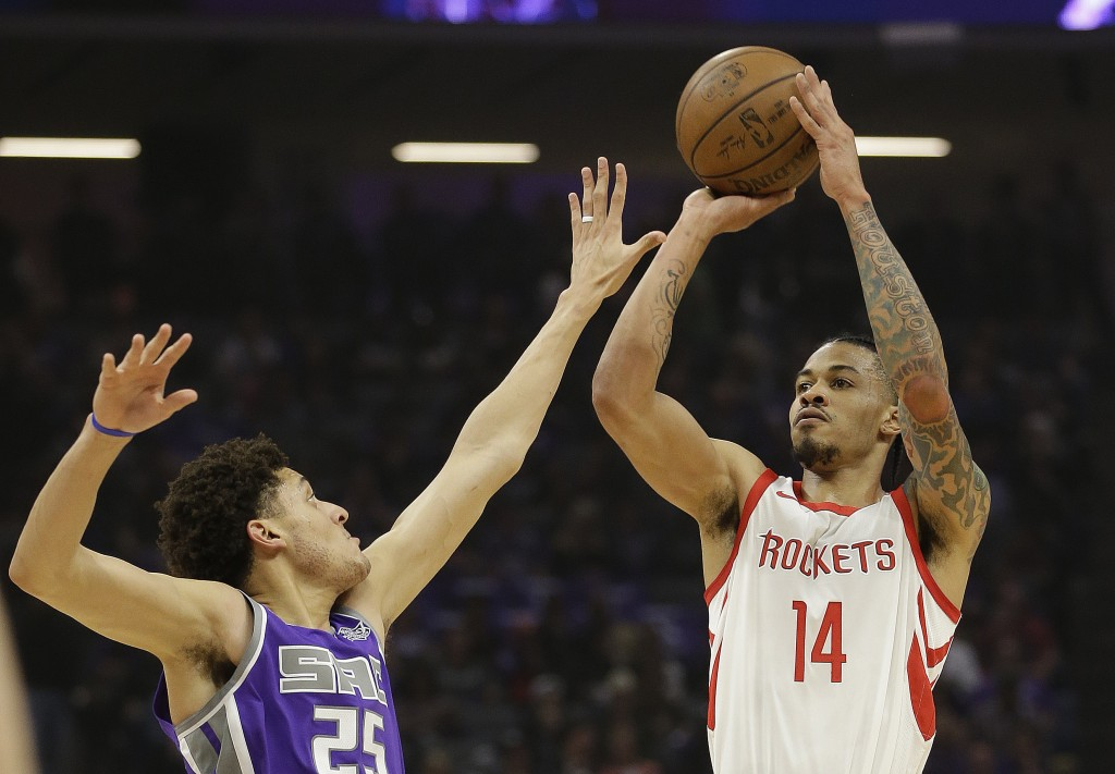 Houston Rockets guard Gerald Green, right, shoots over Sacramento Kings forward Justin Jackson during the first quarter of an NBA basketball game, Wed