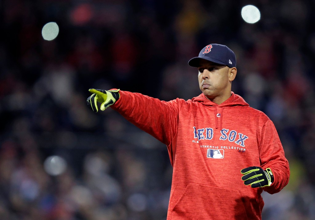 Boston Red Sox manager Alex Cora calls back toward his dugout during the third inning of the team's baseball game against the New York Yankees at Fenw