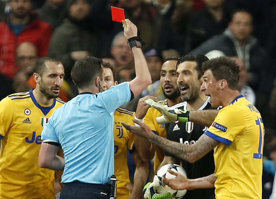 Referee Michael Oliver shows a red car to Juventus goalkeeper Gianluigi Buffon during a Champions League quarter final second leg soccer match between