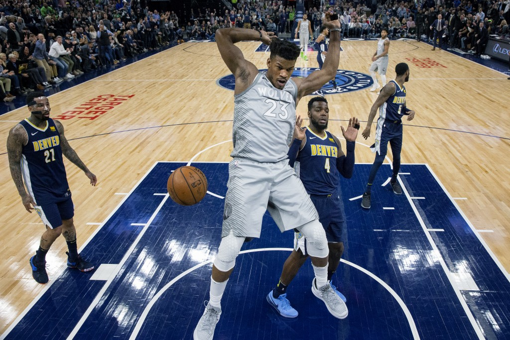 Minnesota Timberwolves Jimmy Butler (23) dunks against the Denver Nuggets during the first half of an NBA basketball game Wednesday, April 11, 2018, i