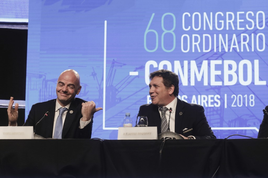 FIFA President Gianni Infantino, left, talks with Alejandro Dominguez, right, president of the South American Football Confederation, CONMEBOL, during