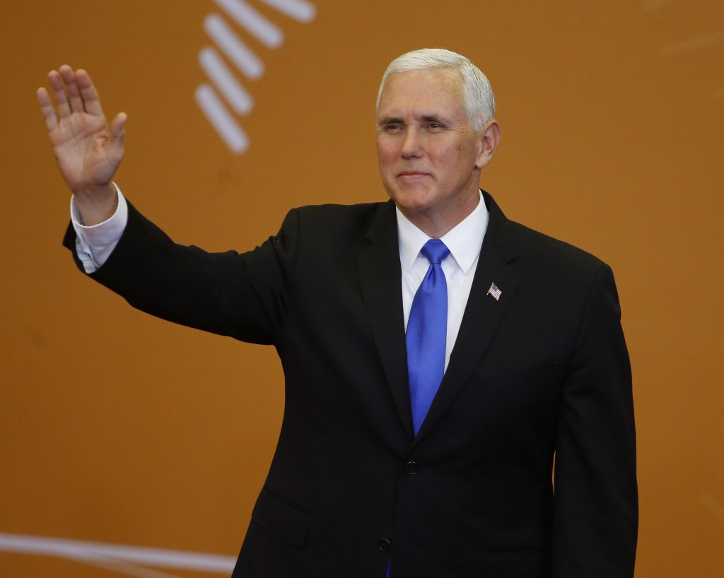 U.S. Vice President Mike Pence waves to the press before the official photo at the Summit of the Americas in Lima, Peru, Saturday, April 14, 2018. (AP
