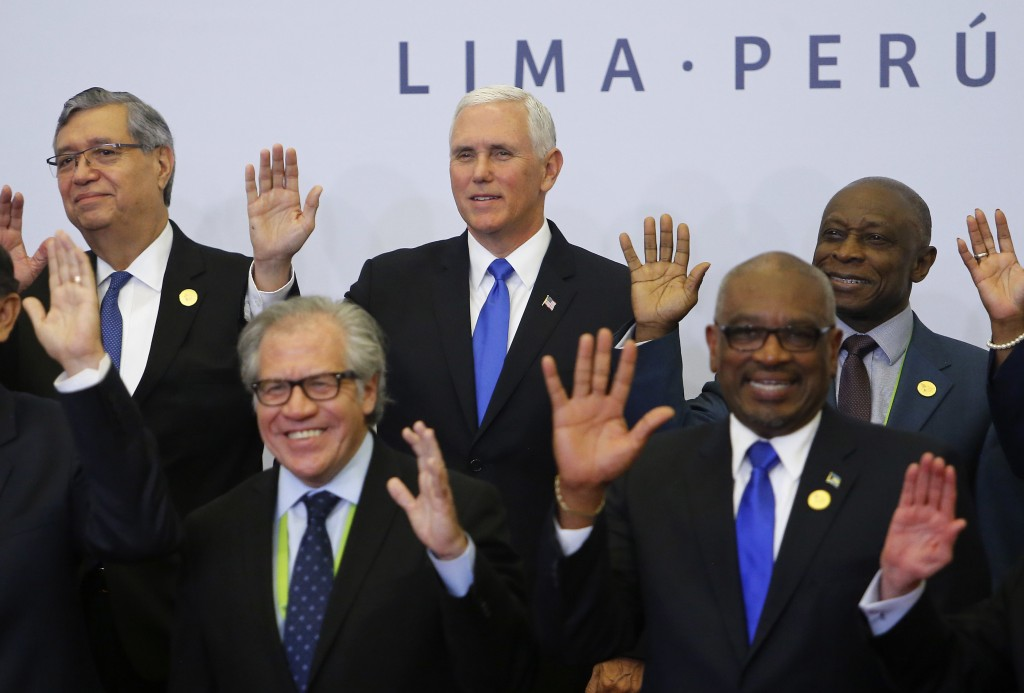 U.S. Vice President Mike Pence, center, waves along with other heads of state, during the official photo of the Summit of the Americas in Lima, Peru,