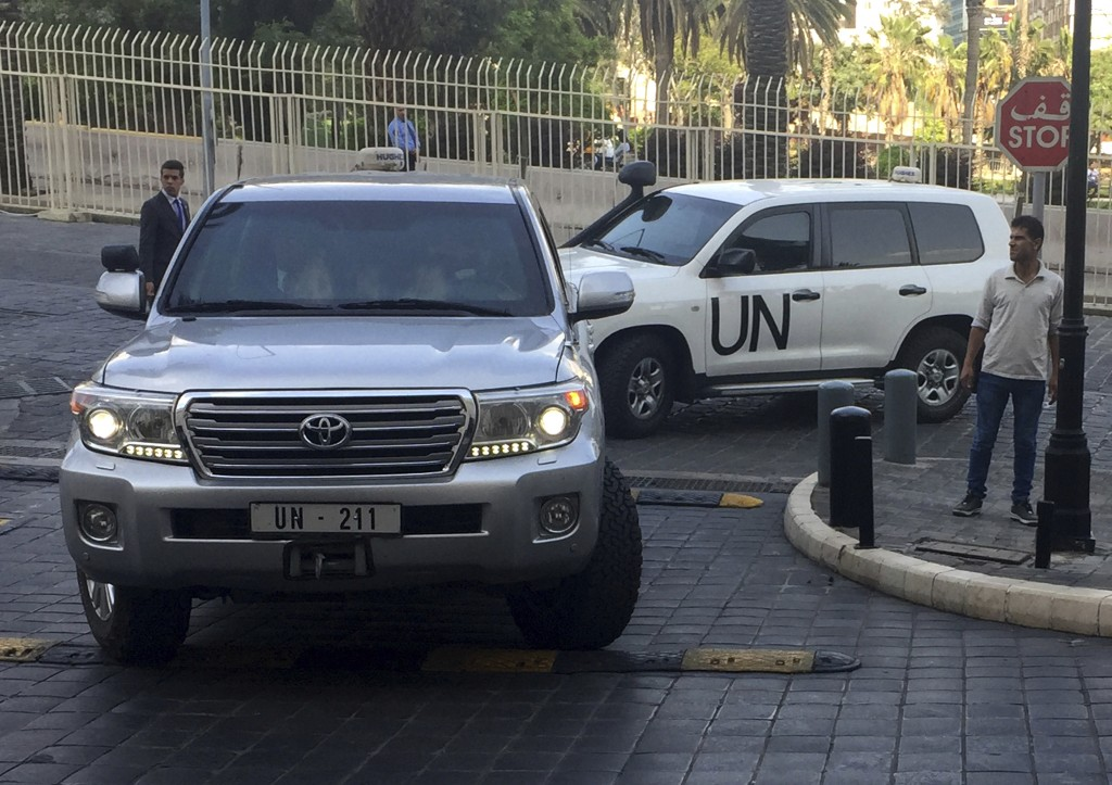 United Nations vehicles carry the team of the Organization for the Prohibition of Chemical Weapons (OPCW), arrive at hotel hours after the U.S., Franc