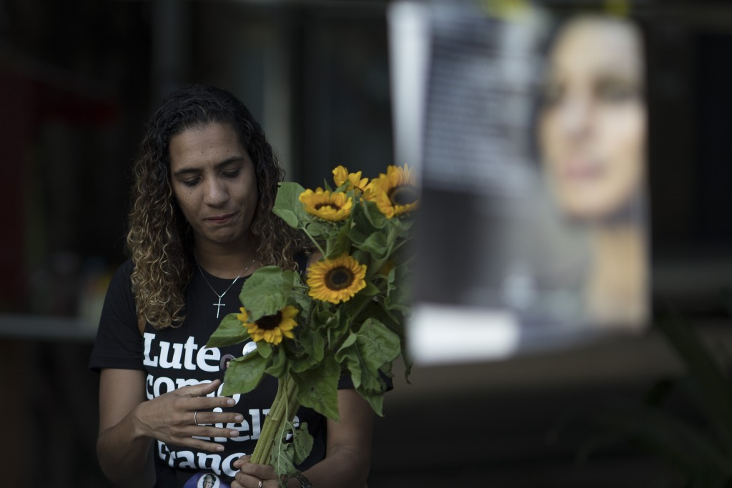 Anielle Franco holds sunflowers as she attends a memorial for her murdered sister councilwoman Marielle Franco and the driver Anderson Pedro Gomes, wh