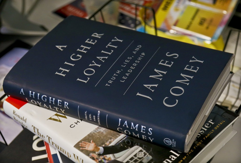 "A copy of former FBI Director James Comey's new book, ""A Higher Loyalty: Truth, Lies and Leadership,"" is on display, Friday, April 13, 2018, in New Yo"
