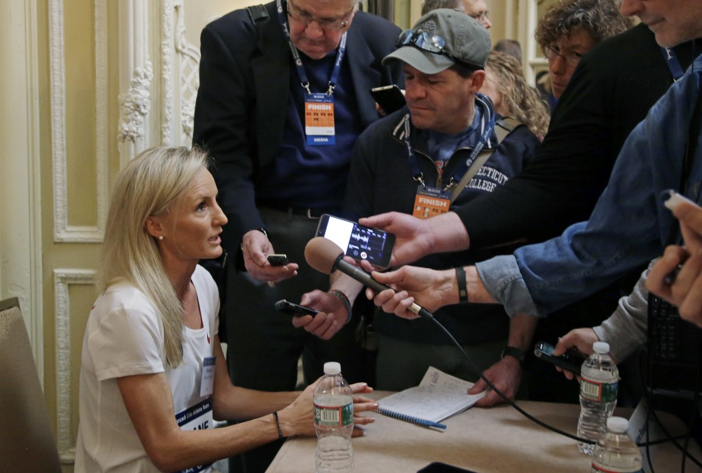 Elite U.S. runner Shalane Flanagan speaks to reporters, Friday, April 13, 2018, in Boston. The 122nd running of the Boston Marathon is scheduled for M