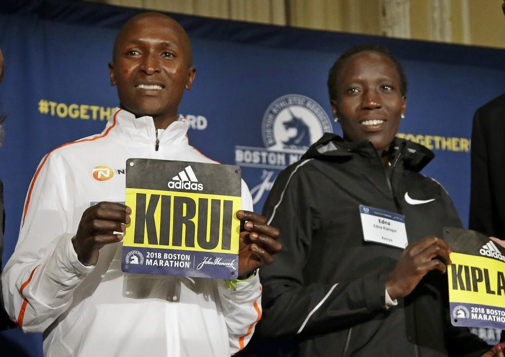 Boston Marathon defending champions Geoffrey Kirui, left, and Edna Kiplagat, both of Kenya, pose for a photo at a news conference, Friday, April 13, 2