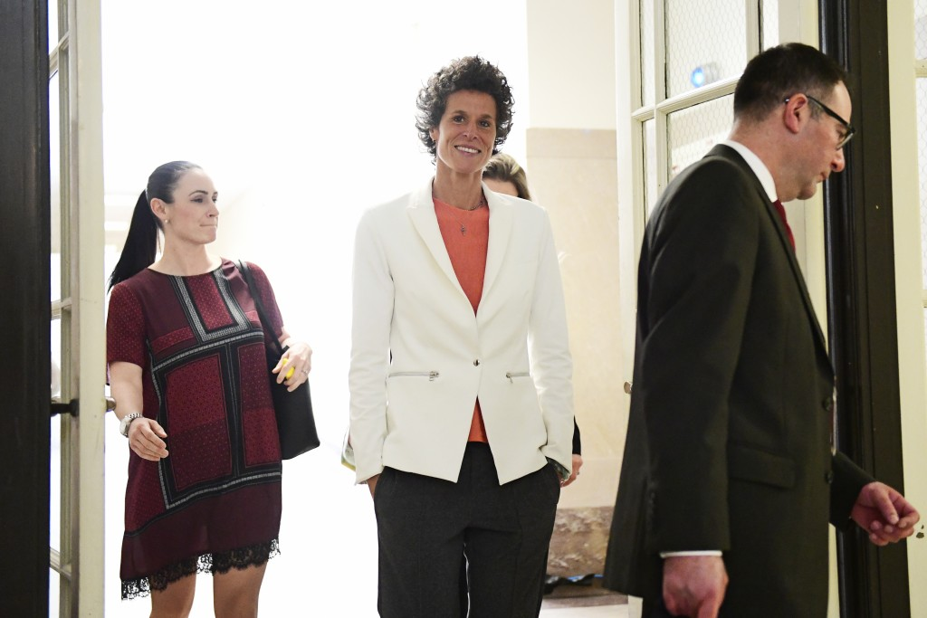 Andrea Constand, center, chief accuser in the Bill Cosby trial, returns from lunch during the Bill Cosby sexual assault trial at the Montgomery County