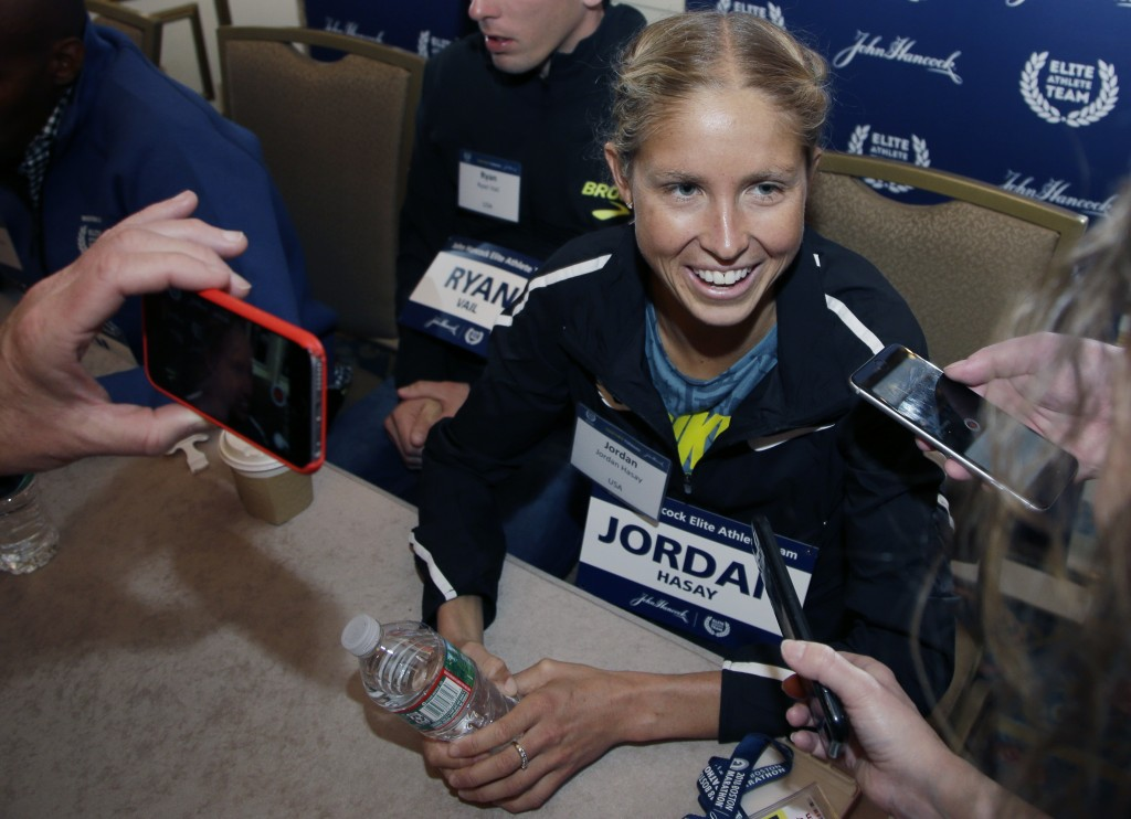 Elite U.S. runner Jordan Hasay speaks to reporters, Friday, April 13, 2018, in Boston. The 122nd running of the Boston Marathon is scheduled for Monda