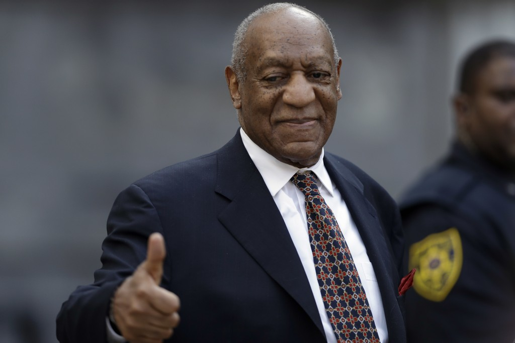 Bill Cosby gestures to supporters as he departs his sexual assault trial, Friday, April 13, 2018, at the Montgomery County Courthouse in Norristown, P