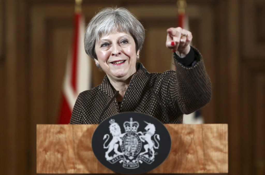 Britain's Prime Minister Theresa May gestures during a press conference in 10 Downing Street, London, Saturday, April 14, 2018. British Prime Minister