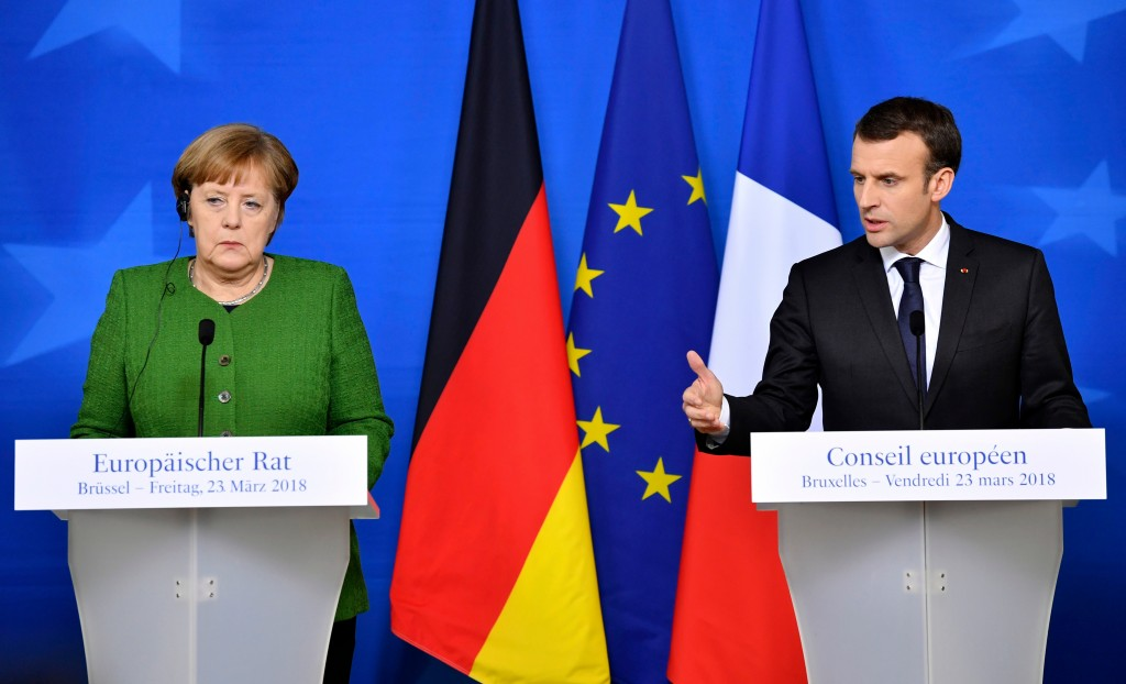 FILE - In this March 23, 2018, file photo, French President Emmanuel Macron, right, and German Chancellor Angela Merkel speak at a news conference in