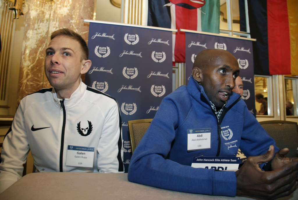Elite U.S. runners Galen Rupp, left, and Abdi Abdirahman speak to reporters, Friday, April 13, 2018, in Boston. The 122nd running of the Boston Marath