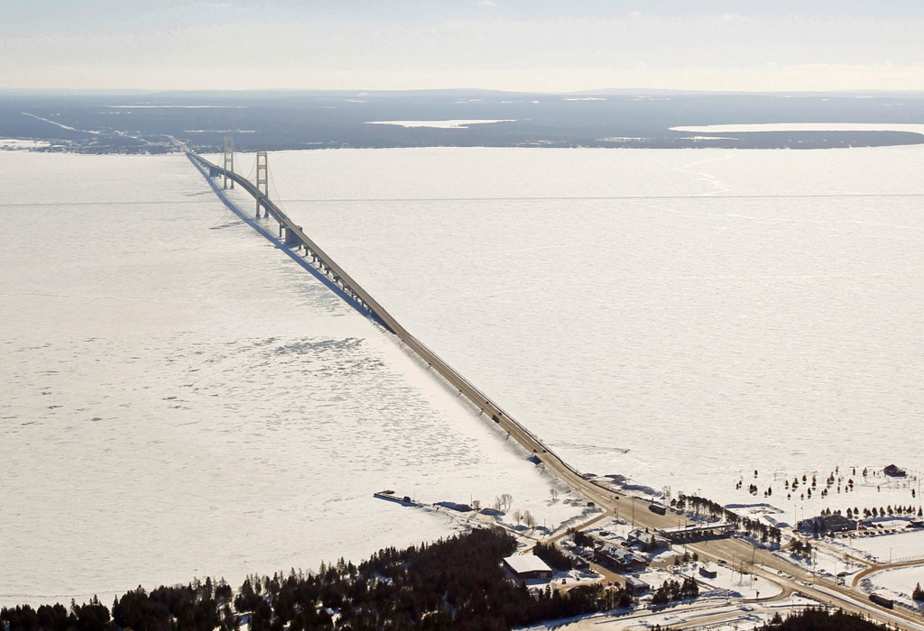 FILE - This Feb. 11, 2014, aerial file photo shows a view of the Mackinac Bridge, which spans a 5-mile-wide freshwater channel called the Straits of M