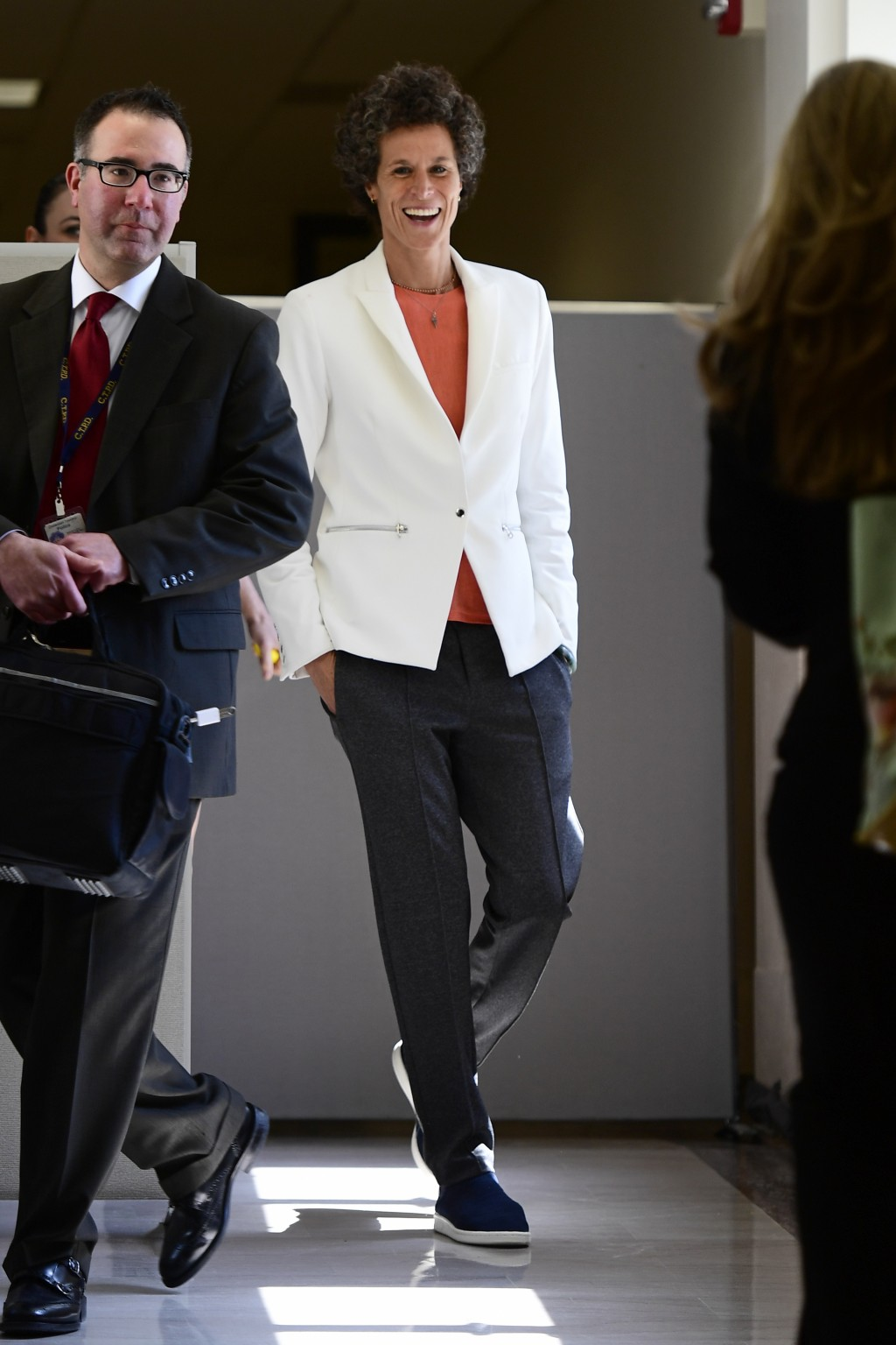 Andrea Constand, chief accuser in the Bill Cosby trial, returns from lunch, spotting a friend, during the Bill Cosby sexual assault trial at the Montg