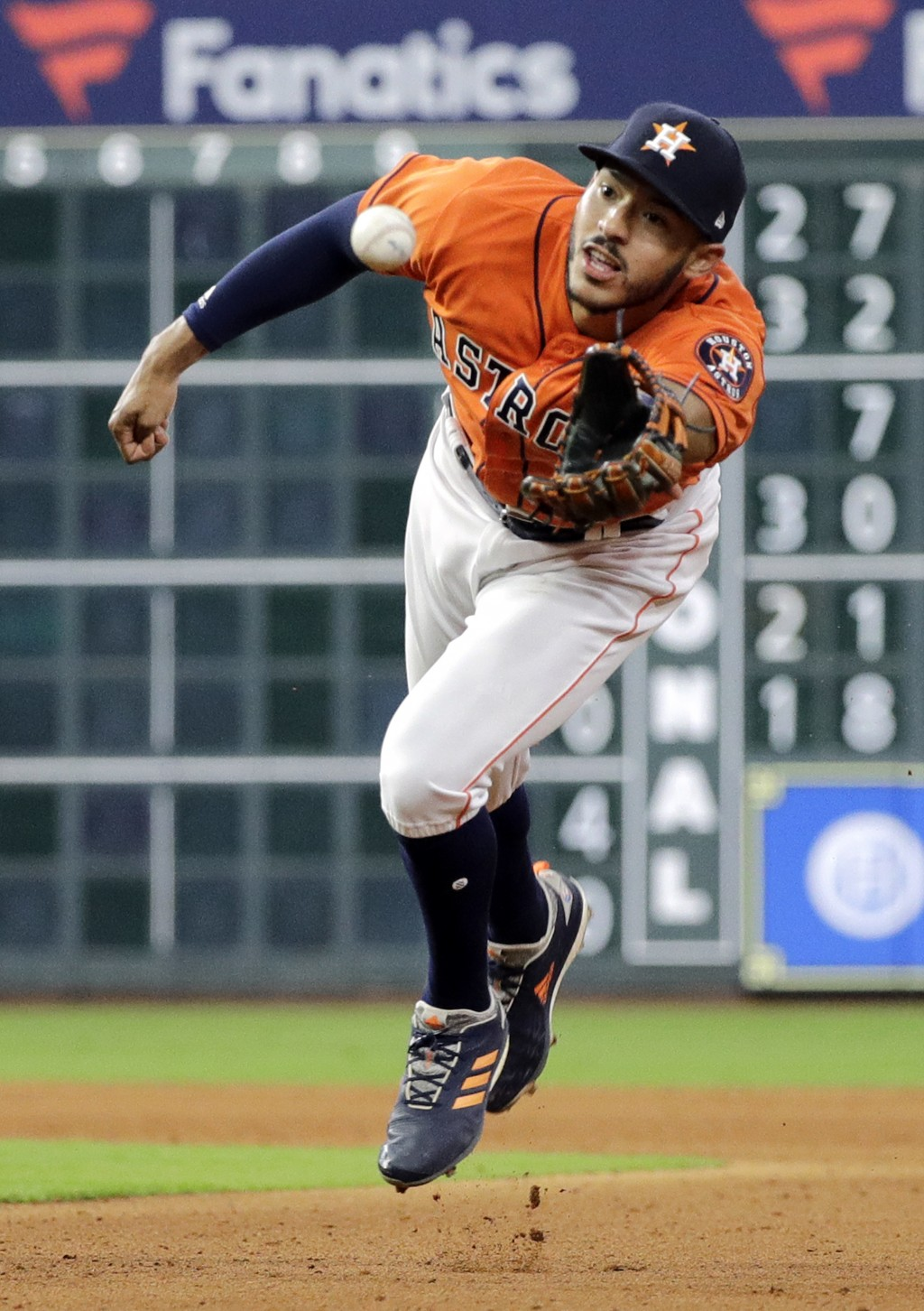 Houston Astros shortstop Carlos Correa tosses the ball with his glove to first baseman Yuli Gurriel after fielding a ground ball by Texas Rangers' Nom