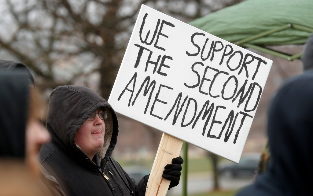 A rally attendee listens to a speaker during a gun-rights rally at the state capitol, Saturday, April 14, 2018, in Des Moines, Iowa. About 100 gun rig