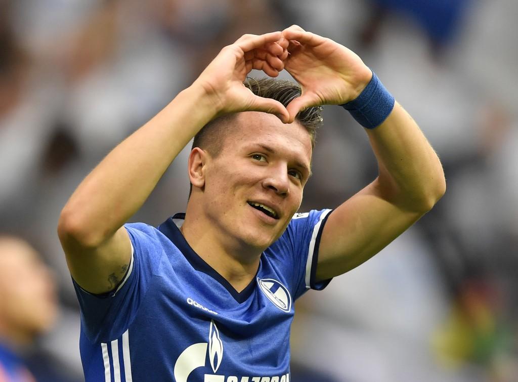 Schalke's Yevhen Konoplyanka celebrates after scoring the opening goal during the German Bundesliga soccer match between FC Schalke 04 and Borussia Do