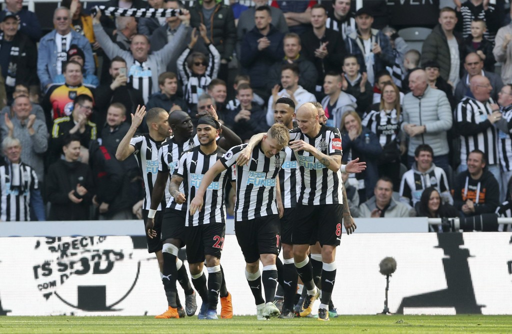 Newcastle United's Matt Ritchie, center, celebrates scoring his side's second goal of the game during the English Premier League soccer match between