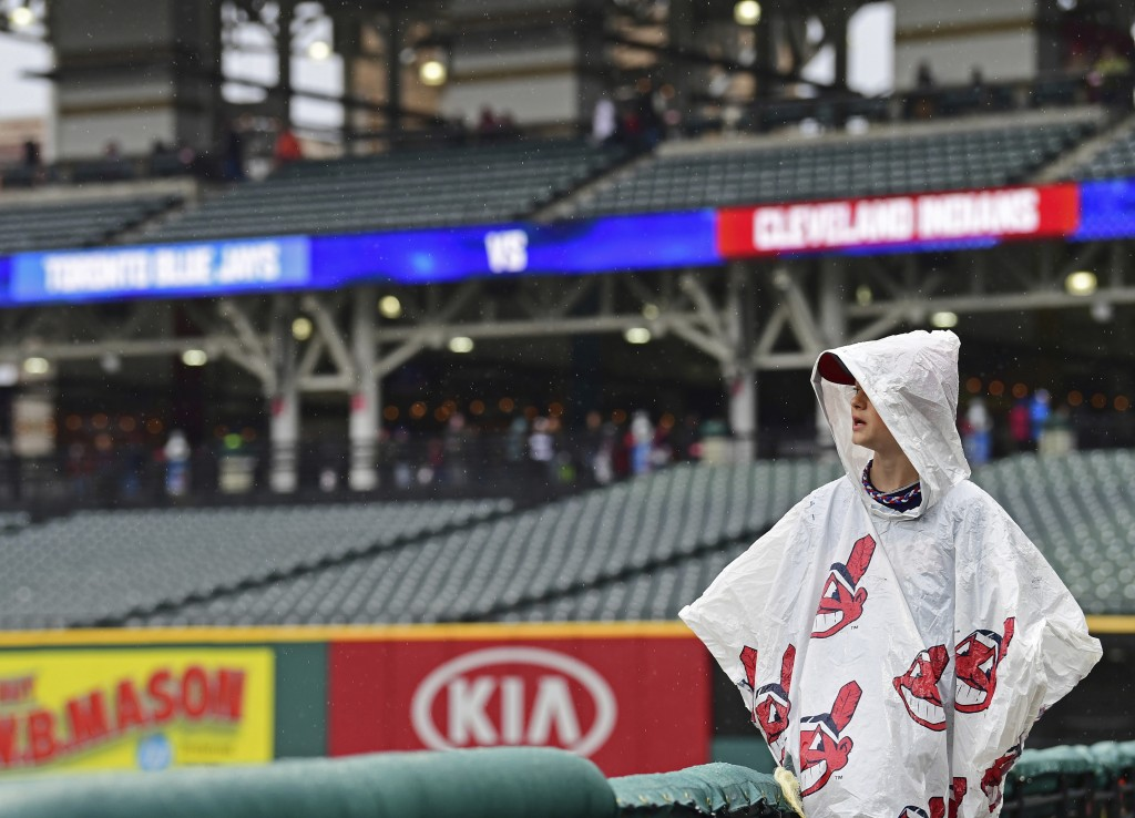 Jake Hofstetter stands during a rain delay in a baseball game between the Cleveland Indians and the Toronto Blue Jays, Saturday, April 14, 2018, in Cl...