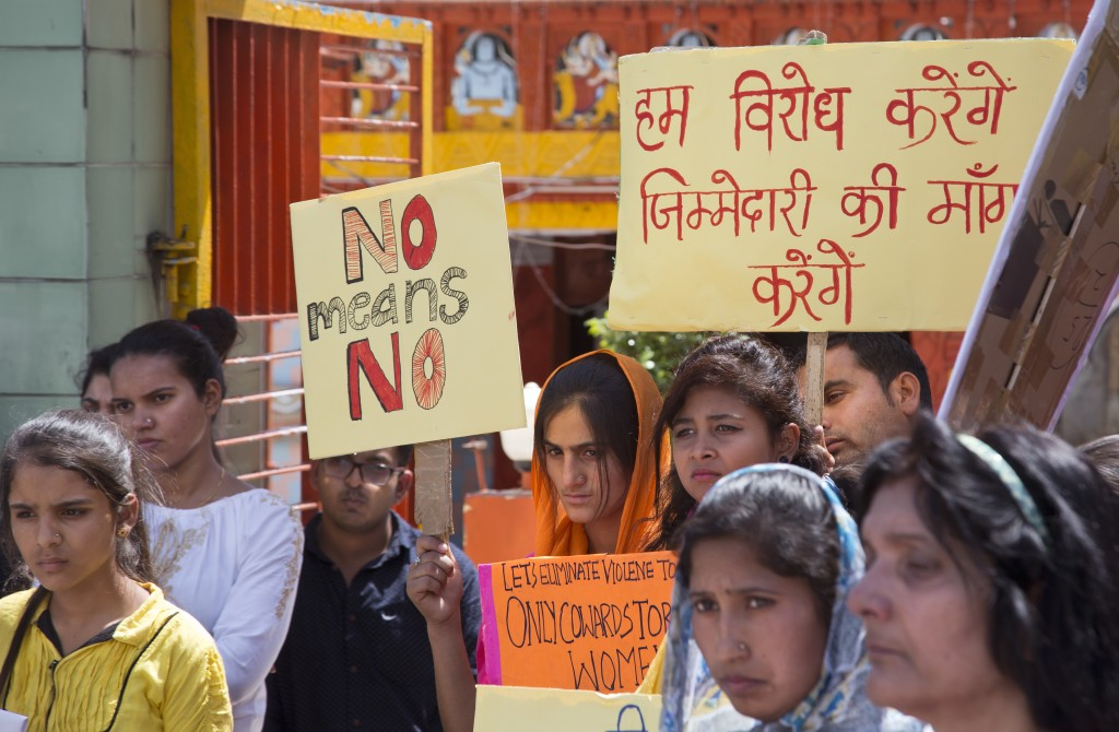 Indian women hold placards during a protest gathering organised by a non governmental organization to condemn violence against women in Dharmsala, Ind...