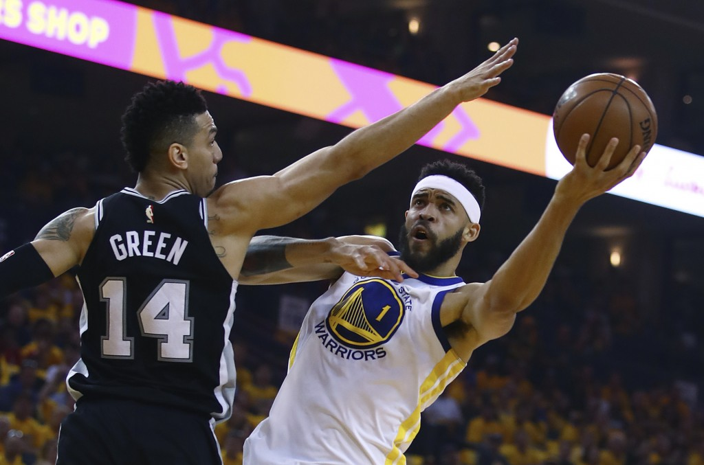 Golden State Warriors' JaVale McGee, right, shoots over San Antonio Spurs' Danny Green (14) during the first half in Game 1 of a first-round NBA baske