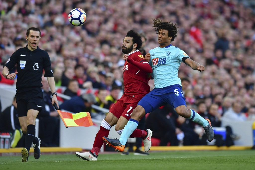Liverpool's Mohamed Salah, left, and AFC Bournemouth's Nathan Ake battle for the ball during the English Premier League soccer match between Liverpool