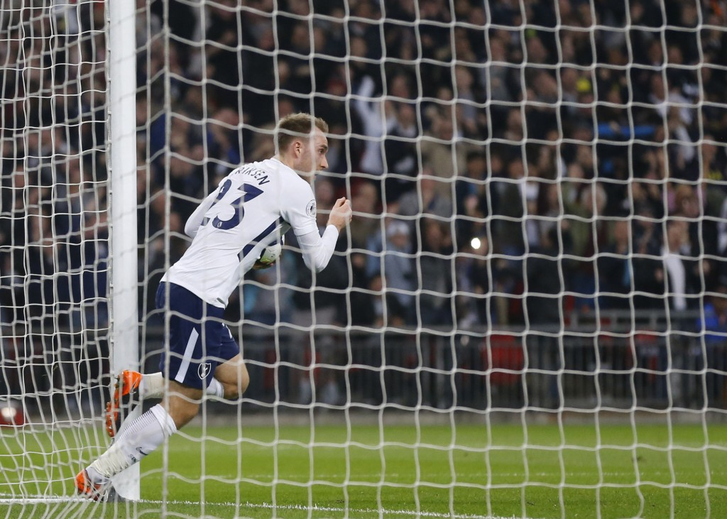Tottenham's Christian Eriksen celebrates after scoring his sides first goal during the English Premier League soccer match between Tottenham Hotspur a
