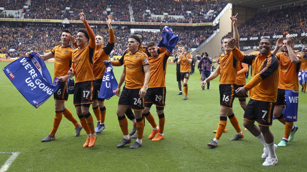 Wolverhampton Wanderers players celebrate winning their promotion to the English Premier League after the Championship soccer match against Birmingham...