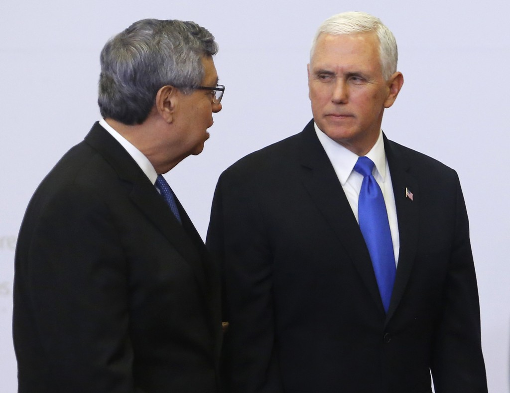 U.S. Vice President Mike Pence, right, speaks with Guatemala's Vice President Jafeth Cabrera during the official photo at the Summit of the Americas i
