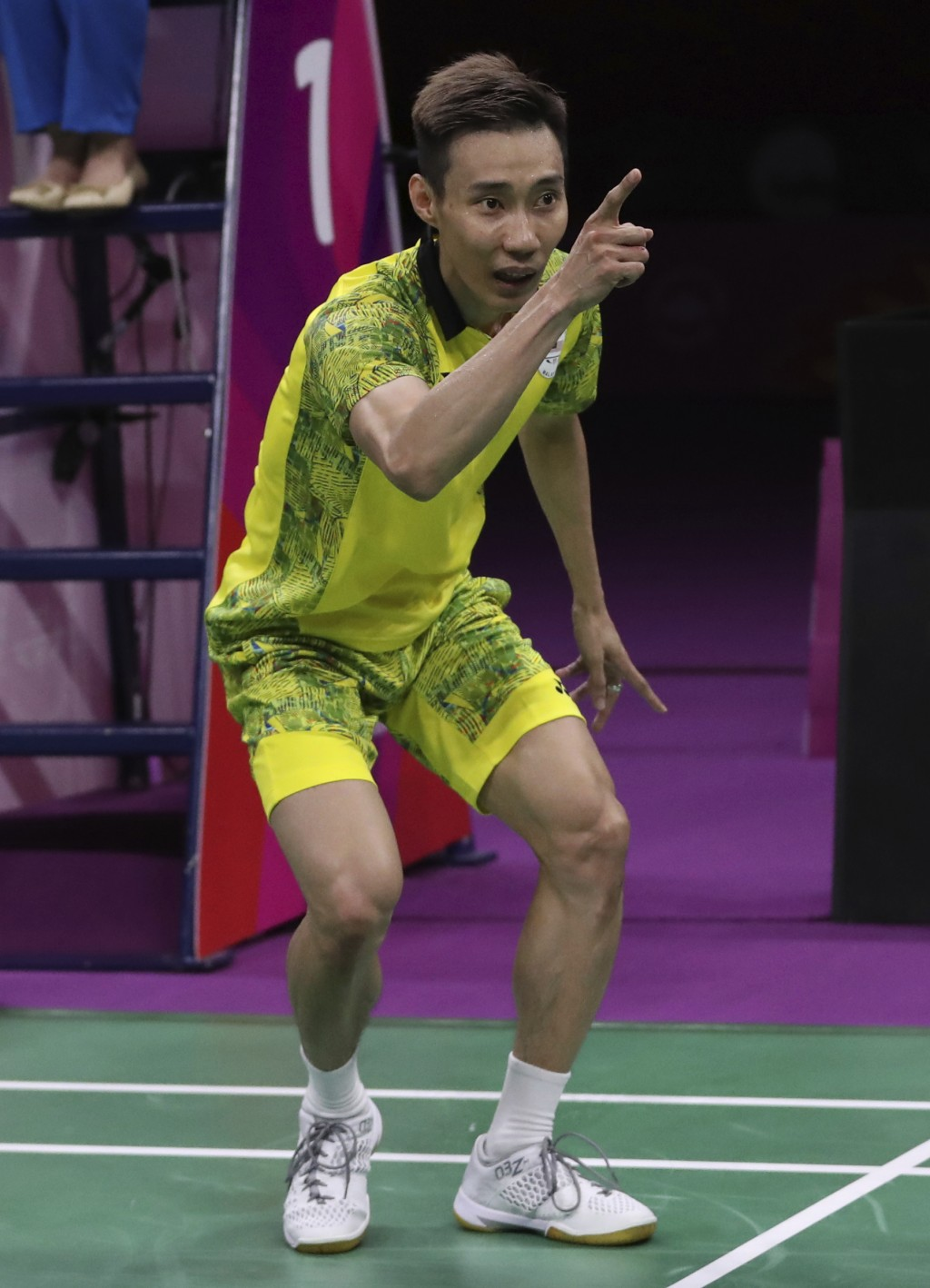 Malaysia's Lee Chong Wei celebrates after defeating India's Srikanth Kidambi during their men's singles badminton final match at Carrara Sports Hall d