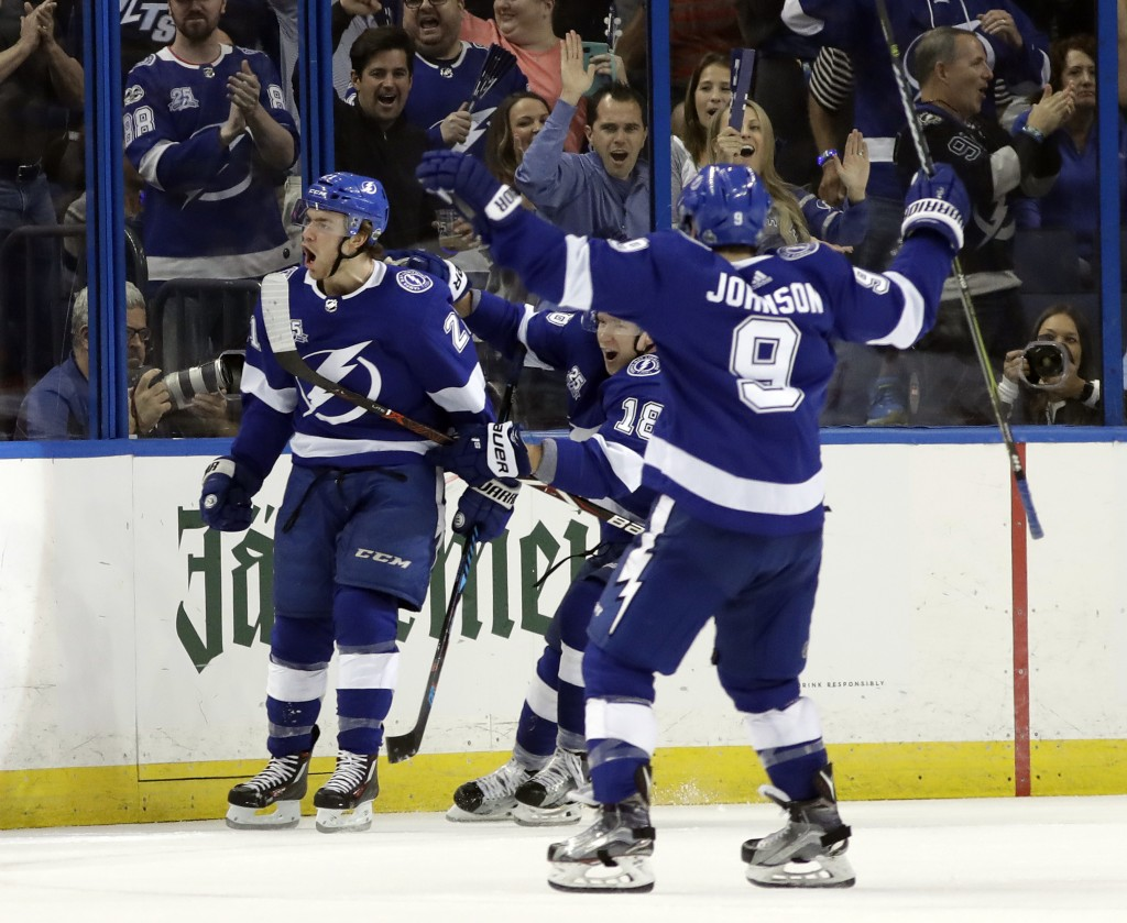 Tampa Bay Lightning center Brayden Point (21) celebrates his goal against the New Jersey Devils with center Tyler Johnson (9) during the first period