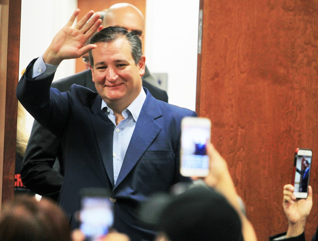 FILE - In this April 2, 2018, file photo, U.S. Senator Ted Cruz, R-Texas, waves to supporters as he enters the room while campaigning for re-election