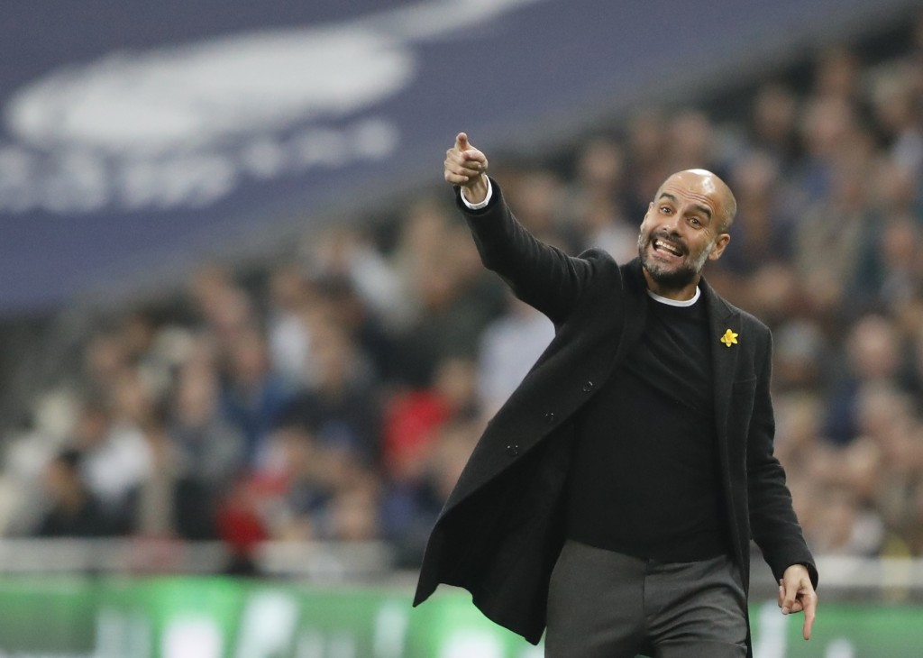Manchester City coach Pep Guardiola reacts during the English Premier League soccer match between Tottenham Hotspur and Manchester City at Wembley sta