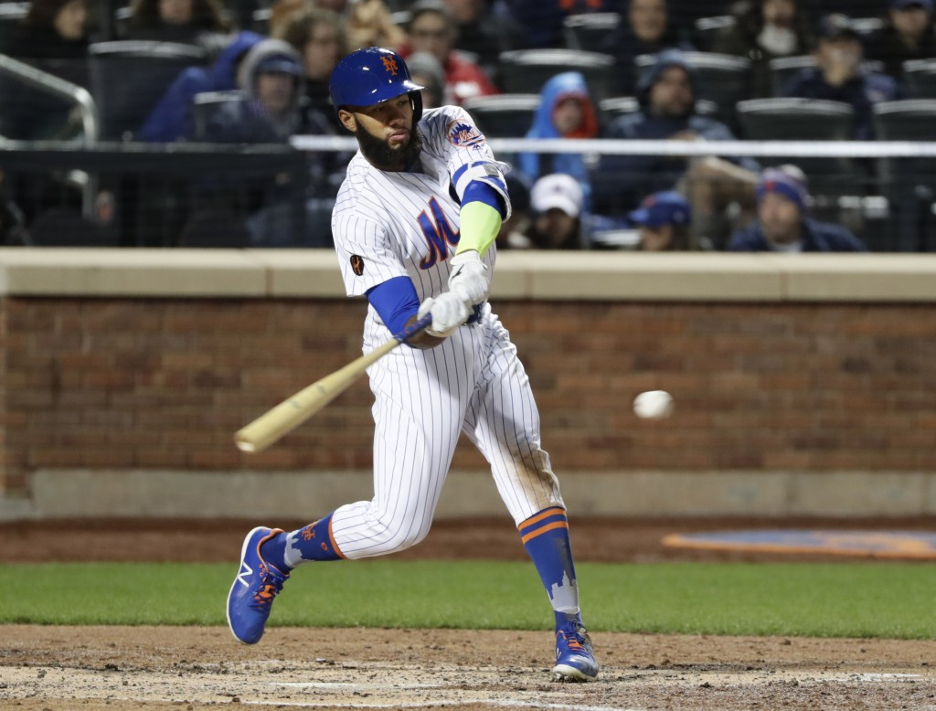 New York Mets' Amed Rosario hits a single during the fifth inning of the team's baseball game against the Milwaukee Brewers on Saturday, April 14, 201