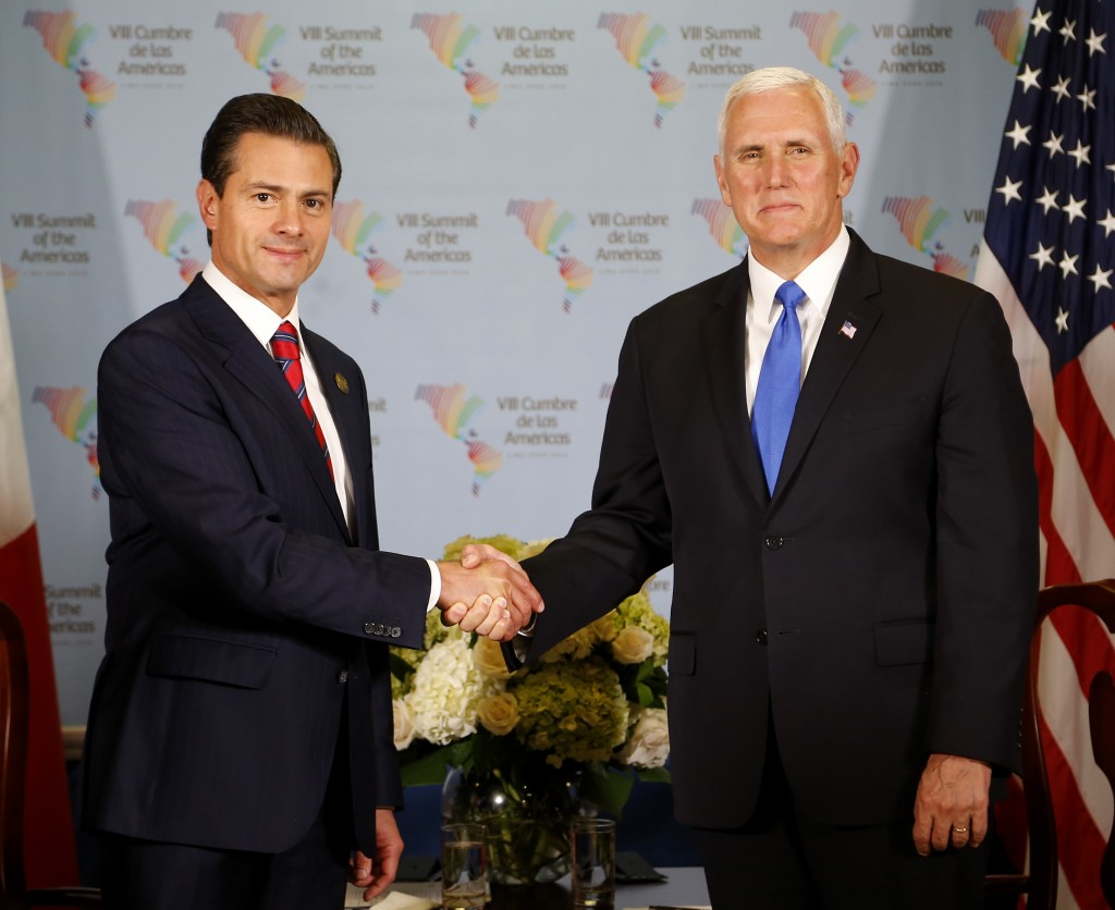 U.S. Vice President Mike Pence, right, shakes hands with Mexico's President Enrique Pena Nieto during a bilateral meeting at the Summit of the America