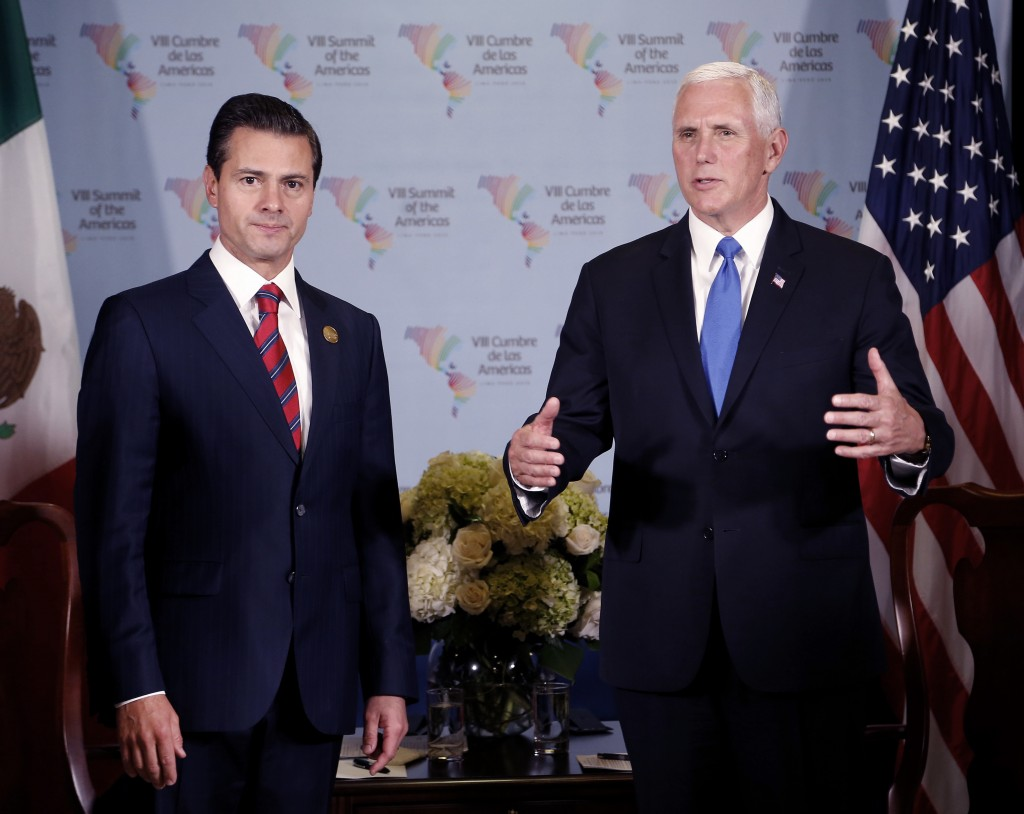 U.S. Vice President Mike Pence, right, speaks during a bilateral meeting with Mexico's President Enrique Pena Nieto at the Americas Summit in Lima, Pe